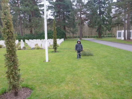 T hauling sticks over to Riccardo's headstone, his own special way of letting him know he was there.