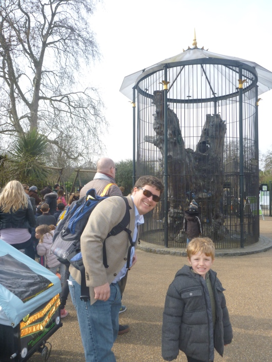 Happy queue-standers C and T outside the Diana, Princess of Wales' Memorial Playground.