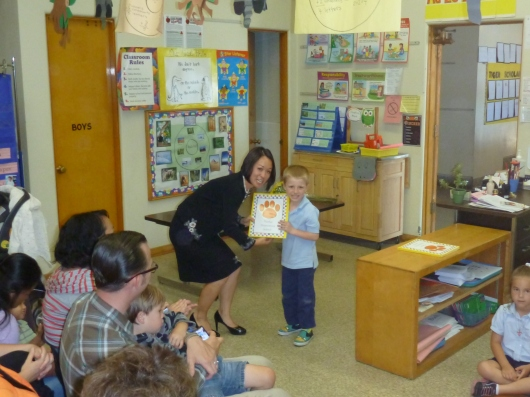 T accepting his certificate from his school principal, Dr. An.