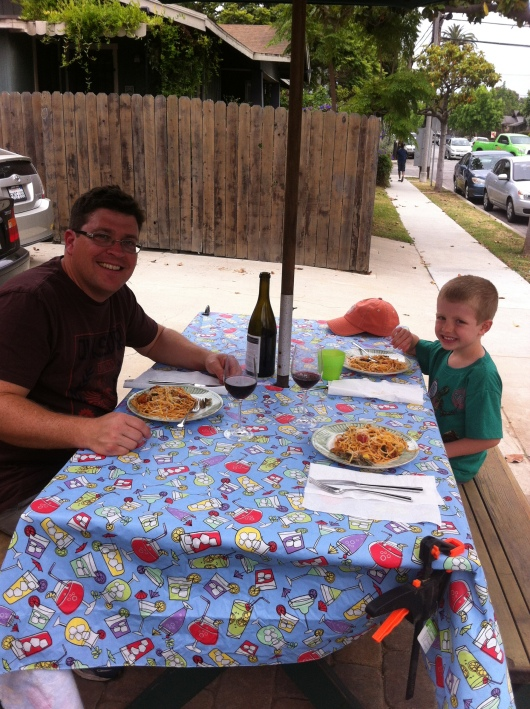 C and T sitting down to the first al fresco dinner in our newly remodeled front yard. Thanks to C for all of his hard work the last three months! Now, have a drink!