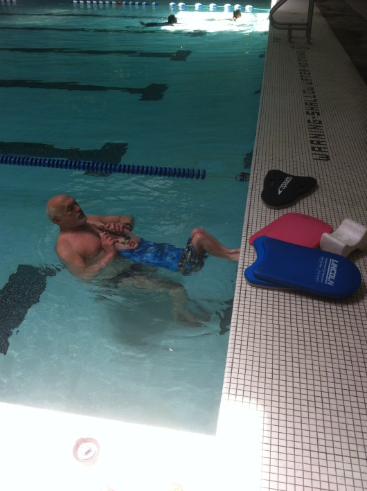 T learns how to start off the wall for the backstroke.