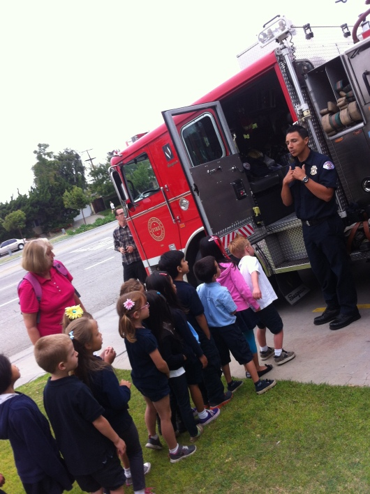 The kids line up for their chance to get on board the fire engine at Station 22 during their field trip.