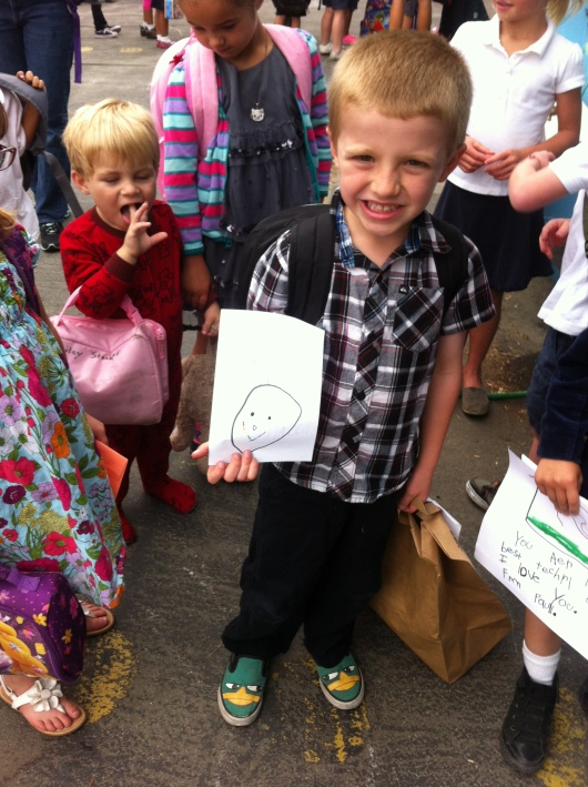 T on his last day of TK holding a card for his beloved teacher, Mrs. Willson.