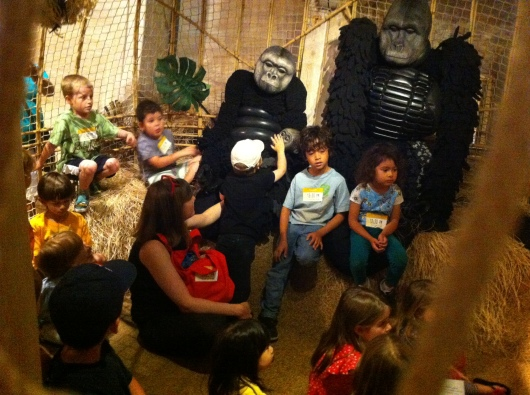 "T listens to the book ""Little Gorilla"" at Noah's Ark at the Skirball Cultural Center."