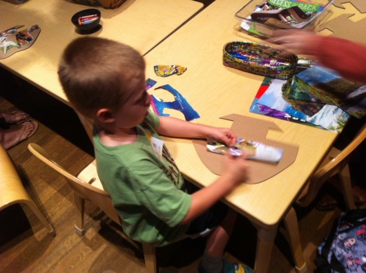 T gets to work making his own ark at the arts and crafts station at Noah's Ark inside of Skirball Cultural Center.