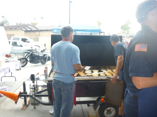 Firefighters cooking up the grub last Sunday.