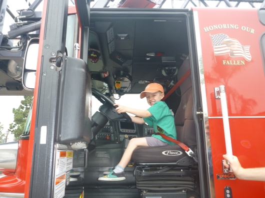 "I love that T buckled up before ""driving"" the fire engine."