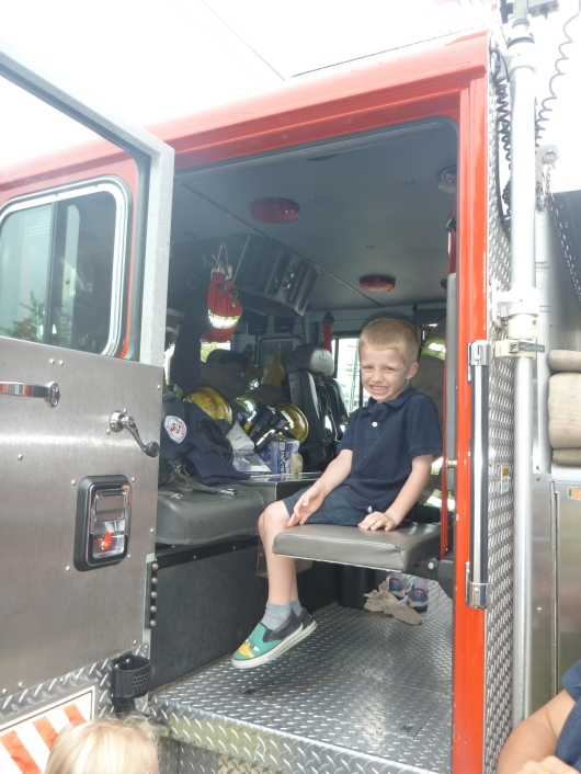 T is loving his field trip at the fire station!