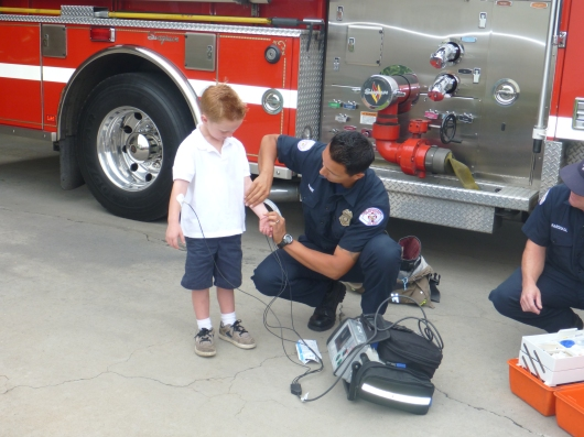 T's classmate got hooked up to the heart rate monitor during his class' field trip to Fire Station 22.