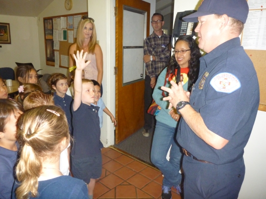 T raising his hand for the umpteenth time during his class field trip to the local fire station. I love that he's not afraid to ask questions!