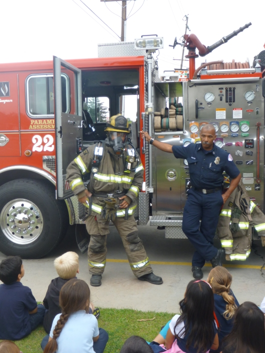 Darth Vader, um, I mean the fire fighter from Station 22 showing off his full garb to the kids during the class field trip.
