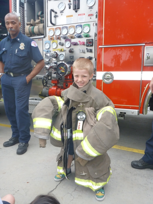 The kids got to try on the coat. They each said it was heavy. Of course, this wasn't but maybe one-fourth the weight of the total standard uniform a fire fighter wears in a typical emergency.
