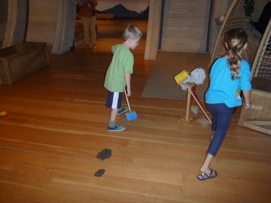 The kids were put right to work cleaning up after all those animals at Skirball's Noah's Ark.