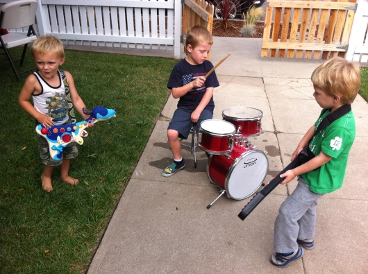 T settles into his new band with new friends made at our neighbors' pancake breakfast.