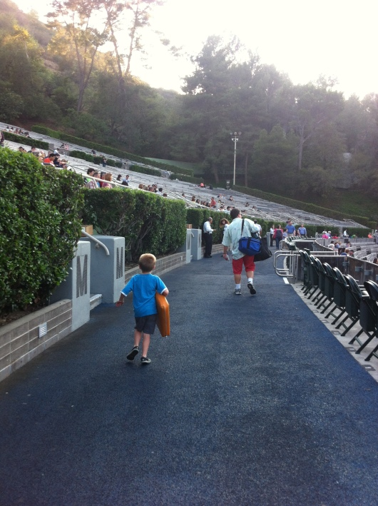 T and C heading toward the seats. Carrying a lot of food and drink is part of the fun of going to the Hollywood Bowl. Yes, you can take in your own food and drinks, including bottles of wine, beer, and other adult beverages of your choosing. Be responsible, RMT'ers!