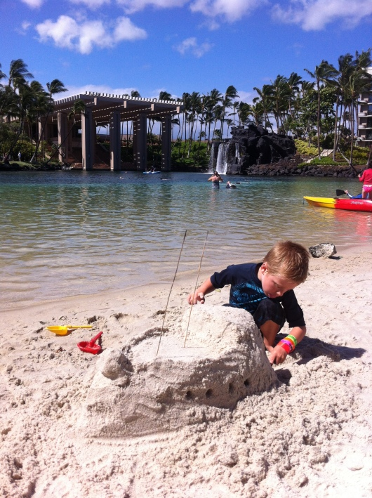 My happy, sandcastle-making T at the Hilton Waikoloa Village on the Big Island, Hawaii.