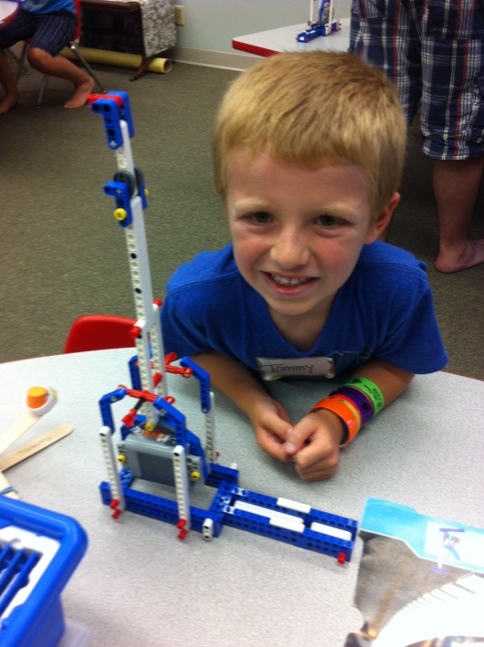 "T and his LEGO trebuchet from Shared Science's summer camp called ""Phantastic Physics Fun."""