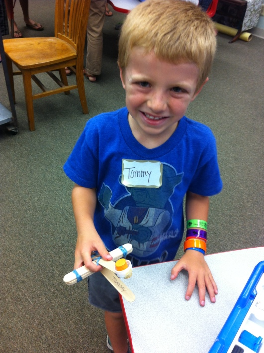 T with his take-home catapult on his first day of Shared Science camp. Yes, he knows the difference between this and a trebuchet, just ask him!