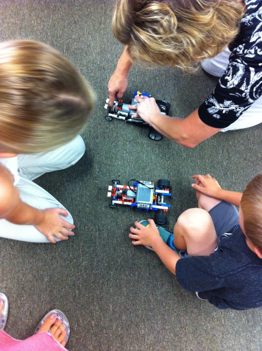 On the final day of camp, the kids put together a LEGO motorized car. The goal was to get it to run, and T's worked with the help of the instructor and other classmates. Everyone works together at Shared Science to help each other succeed, another wonderful part of their devotion to education in whole.