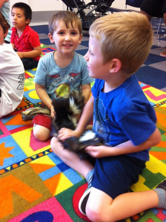The El Dorado Nature Center show was a stinkin' blast! Here's T and his friend with a skunk pelt. And, no, it didn't stink.