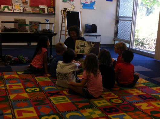 Ms. Dana read to the kids at the end of her presentation. It was very appropriate since the show was held at the library.
