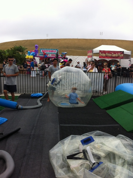 The Bubble Rollers inflate T's hamster ball at the OC Fair.