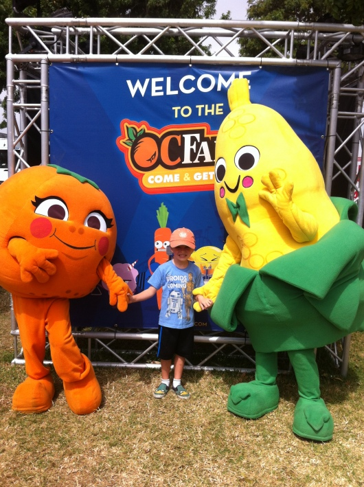 T with the OC Orange and Corn at the entrance to the OC Fair. So corny, T!