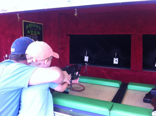 T shoots off his first BB gun ever. Why not? It's the fair and he's with Dad.