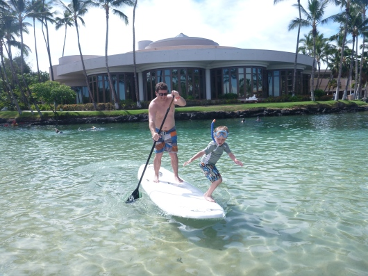 T hanging 10 off the SUP with C... that kid is fearless!