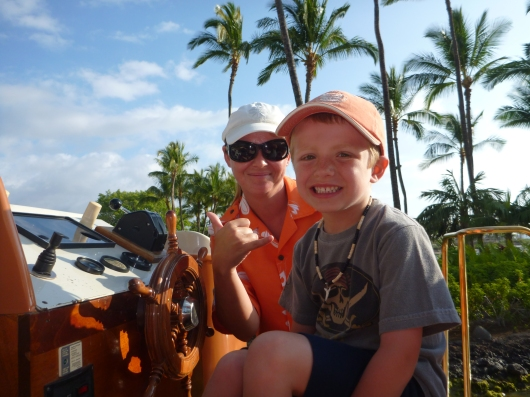 T driving the boat at the HWV with his buddy Crystal. Shaka!