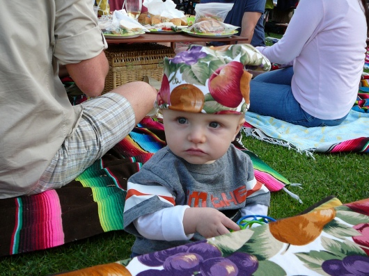 "This is a 9-month-old T in summer 2008 at the concert in the park. I think we put the napkin on his head because of the sun. We must have gotten there early that day! And I miss that little shirt of his (it says ""I'm Da"" with a picture of a fused cannonball)."