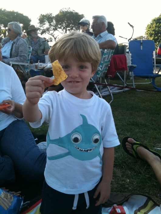 "T is excited about ""snack dinner"" during the concert he attended in 2011 (3-1/2-years-old here)."