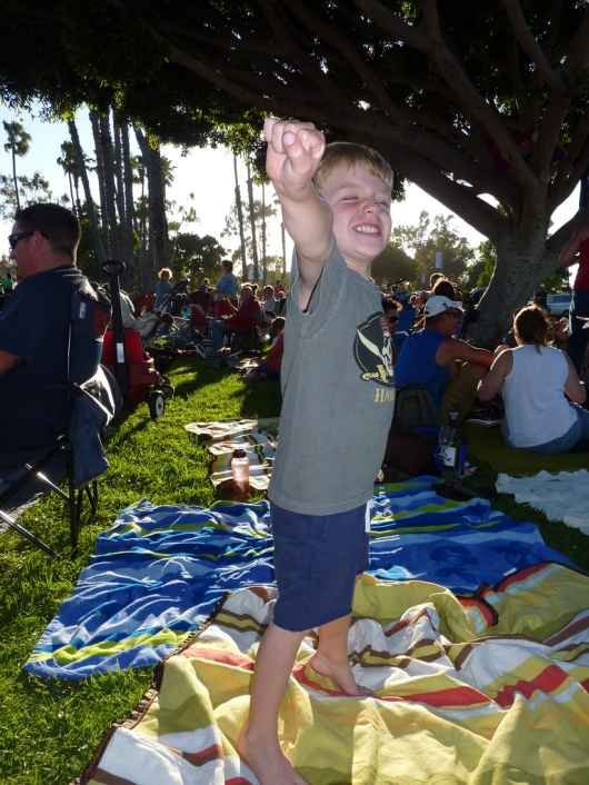 A 4-1/2-year-old T is set to take off at the concert in the park last summer (2012).