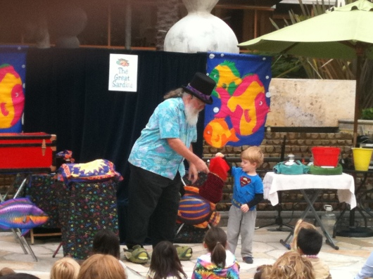 T up on stage with a magician during summer 2011 at Bella Terra Kids' Club.