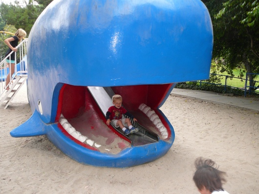 a 1-1/2-year-old T on the whale slide at Atlantis Play Center (taken August 2009).