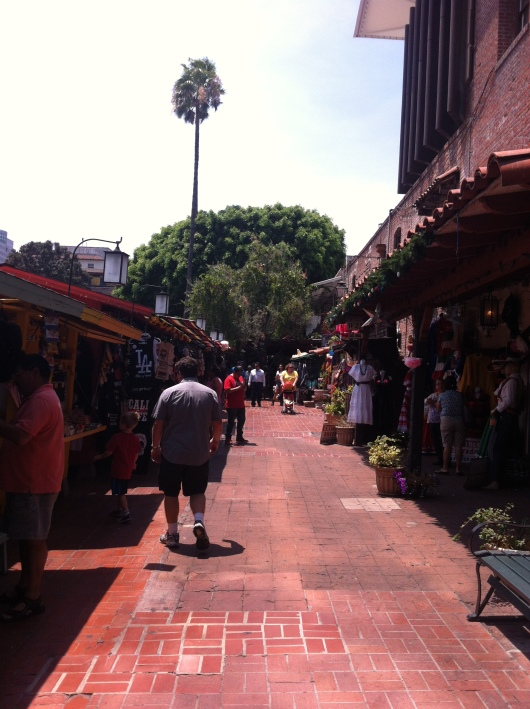 C walking up historic Olvera Street, AKA the birthplace of Los Angeles.