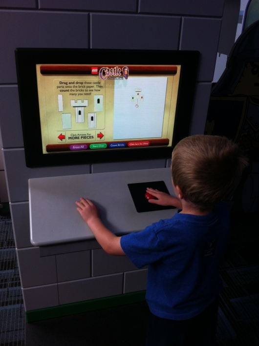 T made plans at this engineering kiosk inside the LEGO Castle exhibit at the Discovery Science Center.