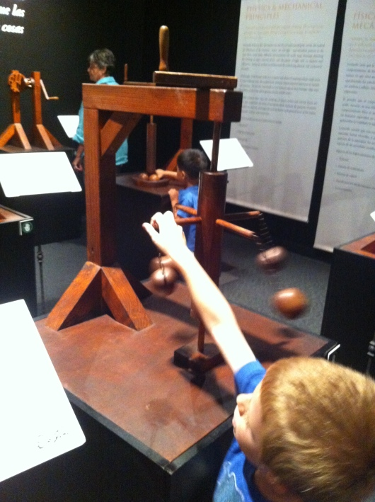 T putting his hands on some of the DaVinci models inside of the special exhibit on now at the Discovery Science Center.