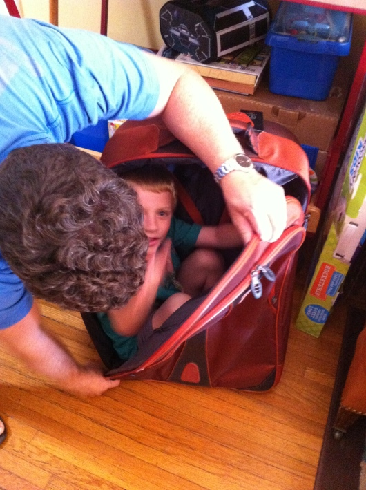 T wanted to get into this suitcase and have C pull him around. Sometimes that's all it takes to keep a kid happy, RMT'ers!