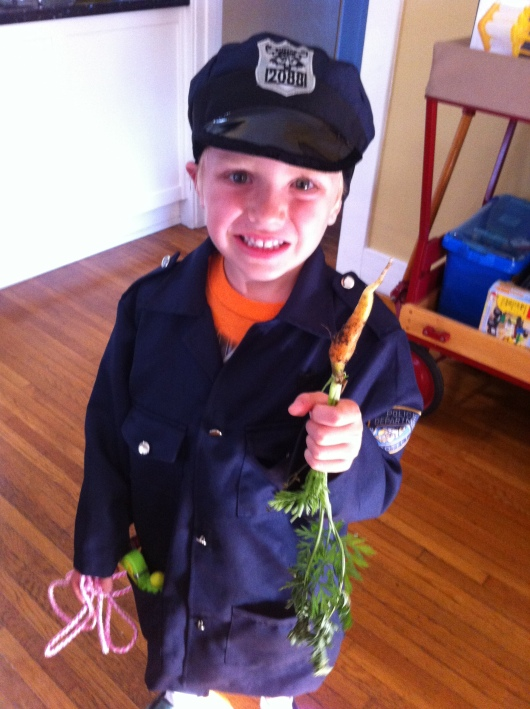 First carrot! Yeah, they need a little more time. Patience, T!