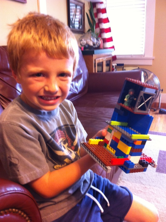 "T showing off his LEGO ""Star Wars bad guy hideout."""