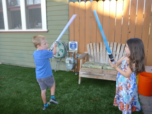 Impromptu lightsaber battles is what having a neighbor kid friend is all about.