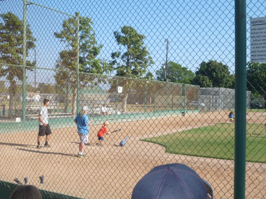 T's second-to-final hit of the T-ball season. I didn't get a pic of the last hit, which was hit-pitch and his best hit of the year!