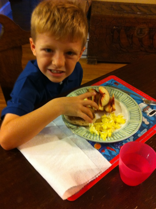 "T's ""whatever"" first day of K breakfast. He ate it all, minus part of the pancake that he took in the car with him."