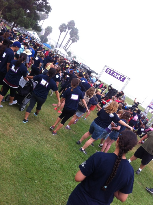Participants kick off the 2013 iWalk... for Kids with some stretching sponsored by Long Beach Boot Camp.