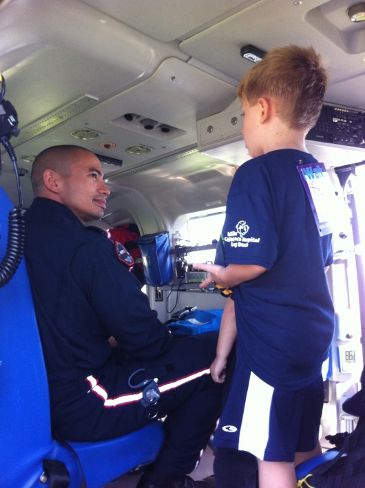 T chats up the Mercy Air helicopter medic at iWalk.