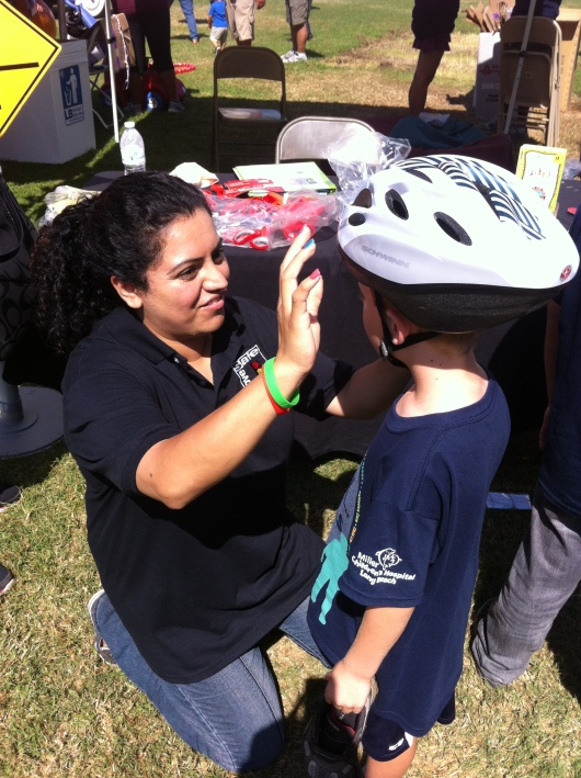 T got fitted for a new (and free!) bike helmet during this year's iWalk... for Kids!