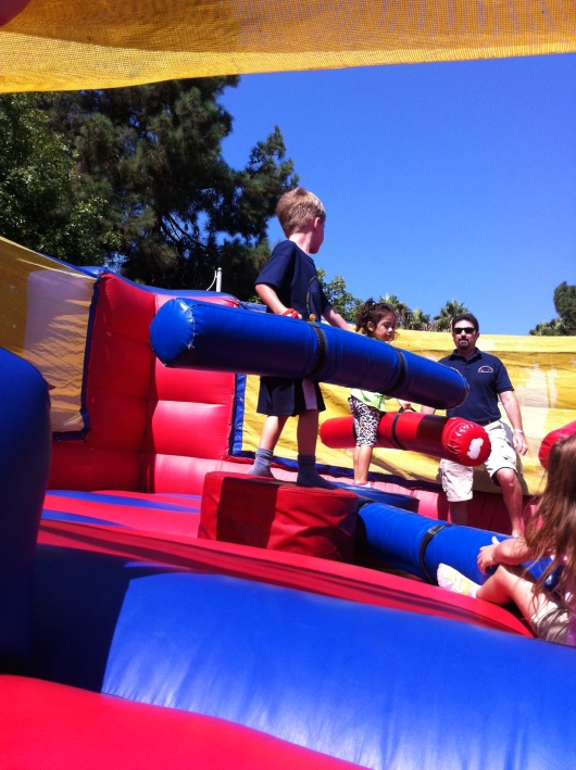 Next up, the kids got to take a whack at cancer in the battle bounce house.
