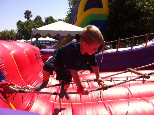 T tackles the horizontal ladder jump.