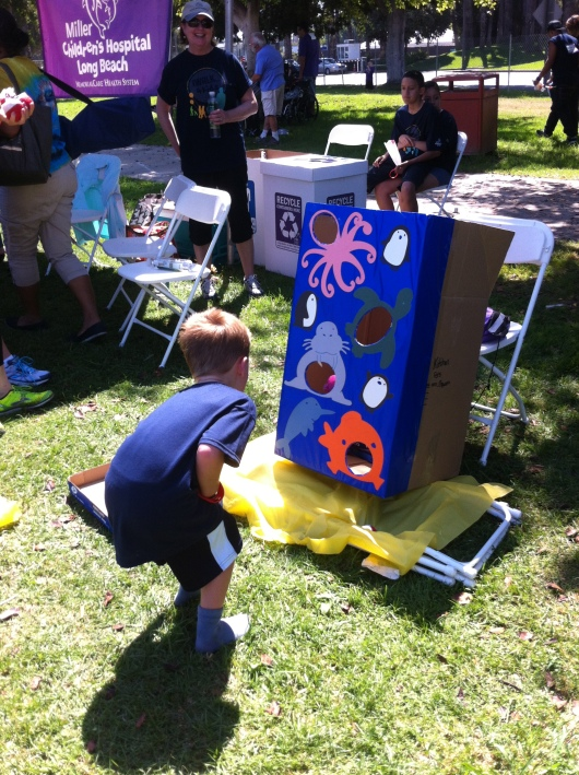 "T at the bean bag toss. He's had a lot of practice since we have that yard game ""cornhole""!"